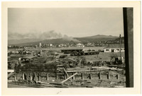 View across lumber yard toward downtown Bellingham,