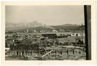View across lumber yard toward downtown Bellingham,