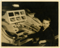 Gunnar Anderson as a young man, seated at an elaborate keyboard, looks back over his shoulder