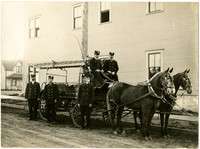 Five uniformed firemen with horse-drawn ladder and hose wagon