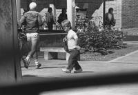 1982 Student Walking Near Rose Garden
