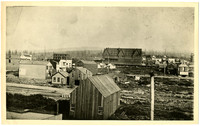 Rooftop view of early Whatcom with the prominent Baker Hotel at center in distance