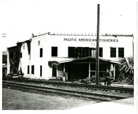 The Pacific American Fisheries office building being dismantled after destroyed by fire