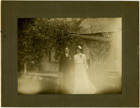 Wedding photograph of Guy W. North and Clara Belle Everett North standing outside house