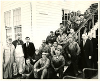 Large group of men outside Pacific American Fisheries' offices