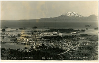 Birdseye view of Sitka, Alaska, with the water in the distance and Mt. Edgecombe on the horizon