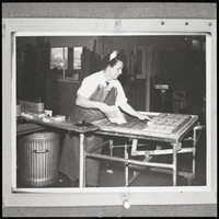 Female fishing processing worker (may be Bornstein Seafoods)