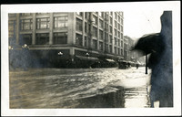Water flooding down city street