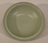 Plate with grooved cavetto and impressed flower in center
