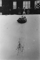 1969 Students Sledding Outside Old Main