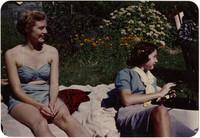 Two women sunbathing on blanket