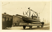 Pacific American Fisheries' parade float of a decorated ship pulled by horse