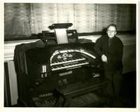 Gunnar Anderson standing next to organ
