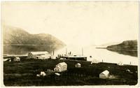 Bayside cannery facility with steamer vessel moored at dock, Matan Bay, Alaska