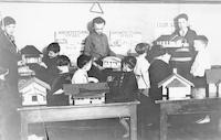 1927 Eighth Grade Boys Showing Playhouse Models To Second Grade