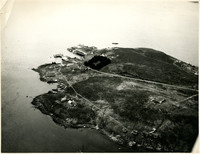 Aerial view of point of land and cannery facility on its shoreline