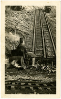 A steam donkey sits at bottom of incline railway that leads to the top of Seattle City Light dam