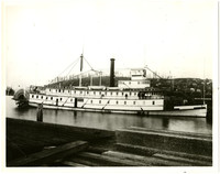 State of Washington stern-wheeler steam ferry with six men standing on board