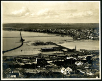 View from above of Bellingham Bay and the city waterfront, with over-water railroad tracks, and industrial piers