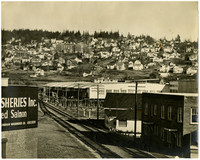 South Hill neighborhood of Bellingham viewed from top of one of the Pacific American Fisheries buildings with railroad tracks extending across foreground