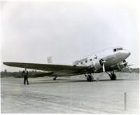 "United Airways ""The Mainliner"" airplane parked on runway"