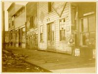 Littered boardwalk outside dilapidated storefronts, Harris Avenue, Bellingham, WA