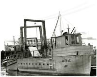 "Wooden boat ""Ark"" (Ark of Juenau) tied at dock"