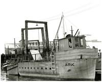 "Wooden boat ""Ark"" (Ark of Juenau) tied at dock"