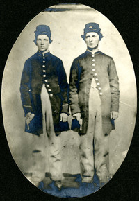 Daniel and William Palmer in their Civil War uniforms holding their army pistols