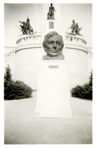 A Washington, D.C., monument with bust of President Lincoln on pedestal in foreground