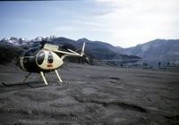 Helicopter used for access to Spirit Lake. The lake is visible behind the helicopter.