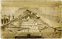 Coos Bay postcard image of workmen constructing interior of ship hull