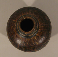 Chalieng ware jar, ovoid body with brown glaze running short of foot