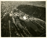 Aerial view of Western Washington University with track at center, and Sehome Arboretum