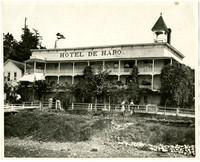 Exterior of Hotel de Haro, a three-story wooden bilding with surrounding balconies, at Roche Harbor on San Juan Island