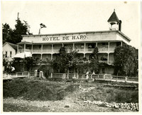 Exterior of Hotel de Haro, a three-story wooden bilding with surrounding balconies, at Roche Harbor on San Juan Island