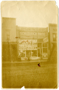 """Schleuder Bros storefront in Bellingham with """"Closing Out Sale"""" banner"""