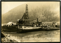 Scow derrick on Skagit River with load of rip rap