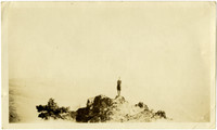 View from afar of man posing on ricky pinnacle