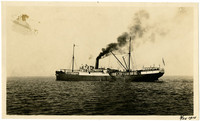Unidentified freight and passenger vessel bearing Pacific American Fisheries insignia plies waters, billowing smoke from stack