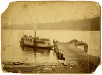 """Small dock on lakeshore with steamer ferry """"Thistle"""""""