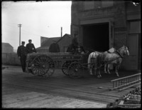 Bellingham fire house with horse-drawn firewagon outside