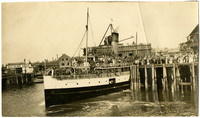 Crowds throng pier and all decks of S.S. Kulshan as it backs into port at Citizen's Dock, Bellingham, WA