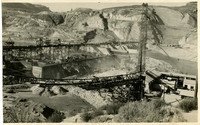 Construction site of massive dam site, possibly Grand Coulee Dam on the Columbia River, Washington state
