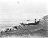 Unidentified man standing next to boat