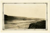 Vista of Columbia River running past basalt cliffs
