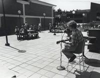 1978 Musician Entertains on Addition Plaza