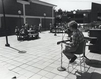 1978 Musician Entertains on Addition Plaza