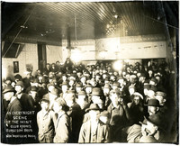 Large group of men gathered at The Mint  entertainment hall