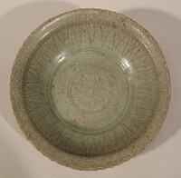 Sawankhalok ware dish, barbed rim, bands of incised lines in interior
